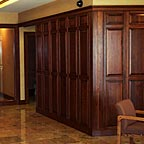 Home Interior Entryway with Wood Panels and Doors